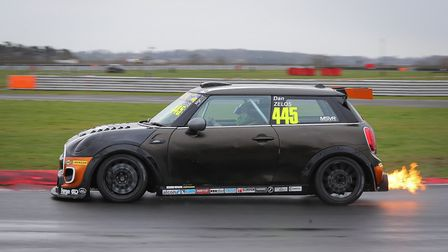 Dan Zelos at the wheel of his Mini Challenge race car run by local team EXCELR8 Motorsport in which
