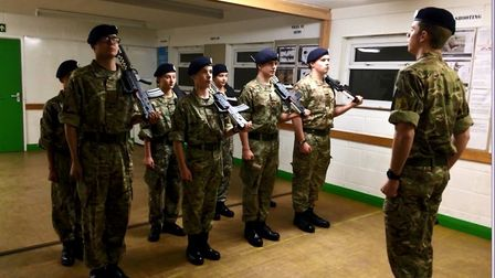 Cadets taking part in rifle drill. Photo:Emily Prince