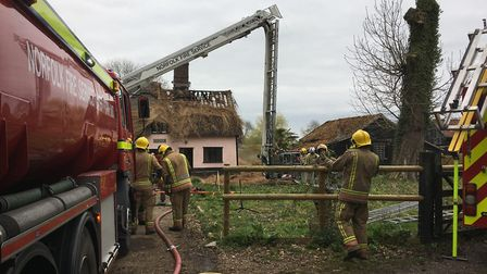 Eight fire crews are tackling a blaze at a thatched cottage at Harris Green. Picture: Simon Parkin