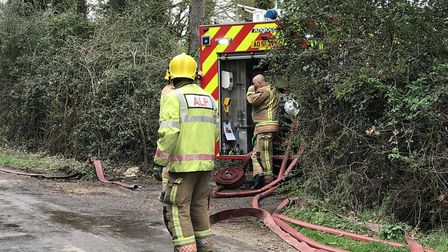 Firefighters at the scene of a blaze in a thatched house at Harris Green, near Long Stratton. Pictur