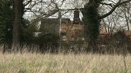 The thatched house at Harris Green, near Long Stratton, that was damaged in the fire. Picture: Victo