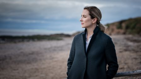 Morven Christie as Lisa Armstrong stares out to sea (C) ITV