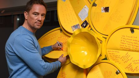 Simon Thomas signing the giant daffodil has part of The Marie Curie Great Daffodil Appeal. Picture: