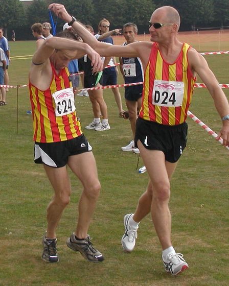 Richard Polley at the Ipswich Ekiden as he changes over with Richard Sales. Picture: Richard Polley