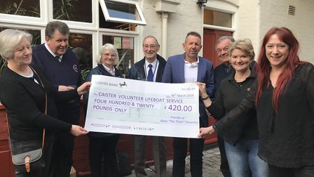 Fundraisers from the King's Head in Norwich, present a cheque to Caister lifeboat, in memory of Dave