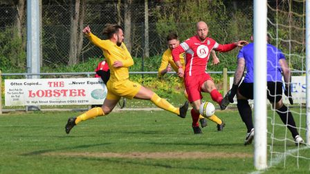 Action from Sheringham's win over Waveney which took them to the top of the Anglian Combination Leag