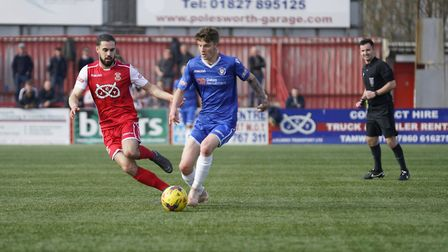 Kyle Barker fends off Tamworth player Claudio Dias Picture: Shirley D Whitlow