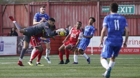 Lowestoft's Shaun Bammant is denied as Tamworth keeper Jas Singh grabs the ball Picture: Shirley D W