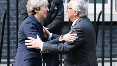 Prime Minister Theresa May greets European Commission President Jean-Claude Juncker at 10 Downing St