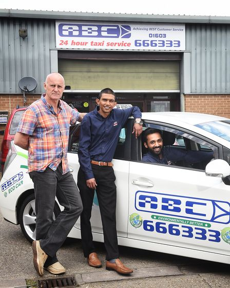 ABC Taxi drivers Russell Ahmed, centre, and Saud Qasim, right, have been subject to racial abuse whi