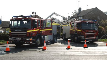Firefighters tackle a blaze at a house in Snettisham. Picture: Chris Bishop