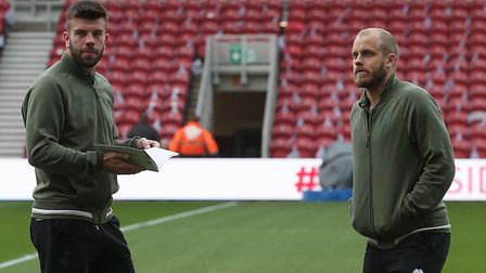 Grant Hanley and Teemu Pukki take in the Riverside ahead of kick-off, which is called the Captain Ja