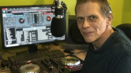 Deaf DJ Ian Luffman is launching a radio station from his home in Wymondham. Picture: Neil Didsbury