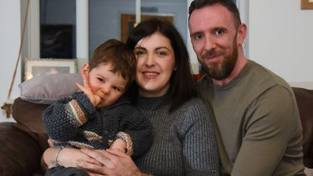 Ali and Matt Hughes, and their 19-month-old son Charlie who has infantile spasms. Picture: DENISE BR