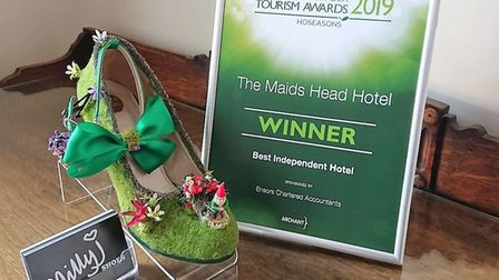 The unusual new tourist attraction at the Maids Head Hotel: the 'English Country garden' shoe by Emi