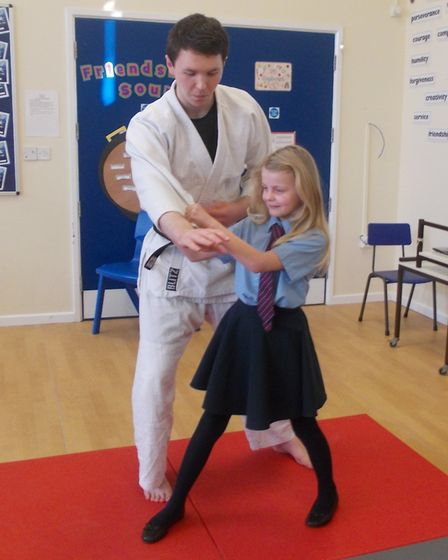 Amelie in Year 4 at Ludham Primary School got to grips with Judo instructor Mark Brown during his de