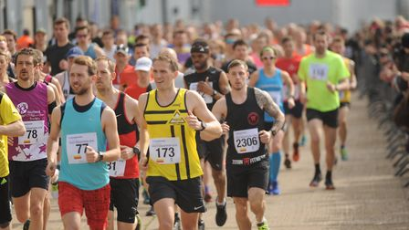 Runners get on their way at the start of the City of Norwich Half Marathon. Picture: Ian Burt