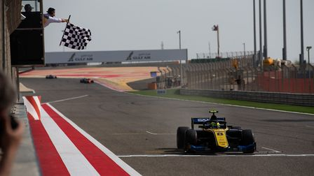 Luca Ghiotto taking the chequered flag in his UNI-Virtuosi Racing run FIA Formula Two car after the