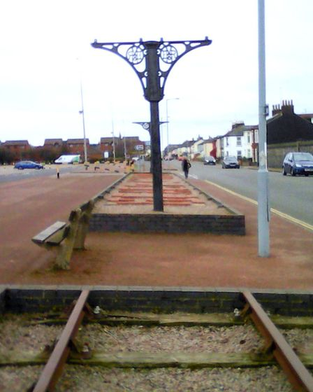 Railway reminders: a fancy post, once supporting a platform canopy, and a short length of track on t