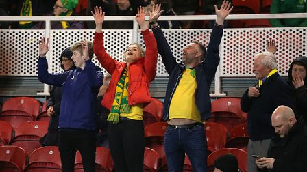 The travelling Norwich City supporters celebrate victory at the Riverside. Picture: Paul Chesterton/