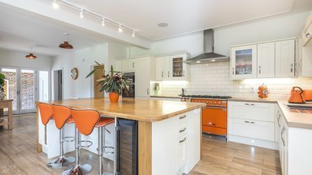 This colourful kitchen is part of the property's open-plan living space. Picture: Warners