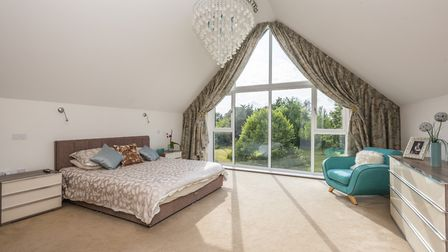 The master suite boasts floor to ceiling windows which offer stunning rural views. Picture: Warners