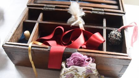 A box containing a thimble, a pomander, and ribbon in Lady Paine's bed chamber at Strangers' Hall. P
