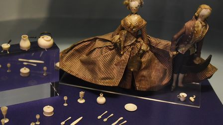 Miniature dolls with miniature cutlery, believed to be made from bone, on display at Strangers' Hall