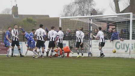 Lowestoft captain Josh Curry turning to celebrate after scoring against Coalville Town Picture: Shir