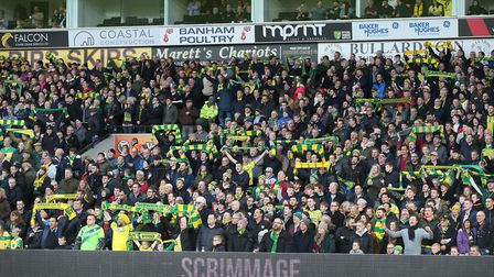 The home fans in the River End display the yellow and green before the Sky Bet Championship match at