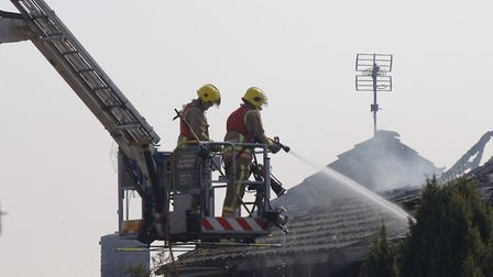 Firefighters tackle a house fire. Fire chiefs say they have no plans to train up firefighters to giv