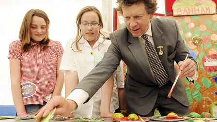 Sir Nicholas Bacon decorating an apple at the Banham Primary School Stand at the 2010 Royal Norfolk