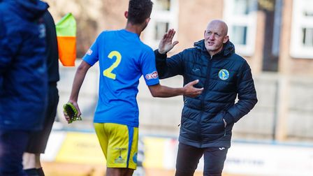Ross Barrows goes off, with the congratulations of King's Lynn Town's assistant manager Paul Bastock