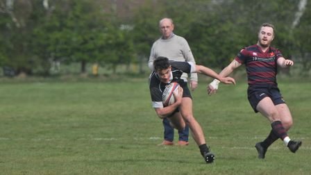 Ally Hughes heads for the line to score Holt's third try of the afternoon Picture: STUART YOUNG