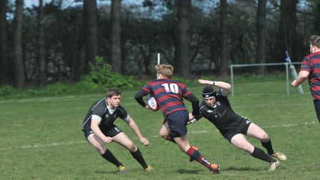 Jeremy Seaman and Henry Harrison combine to close down an East London attack during Saturday's play-