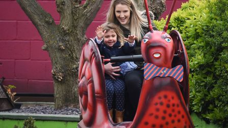 Kirsty Friday and her daughter Darcie, two, ride the ever popular Joyland Snails at Great Yarmouth w