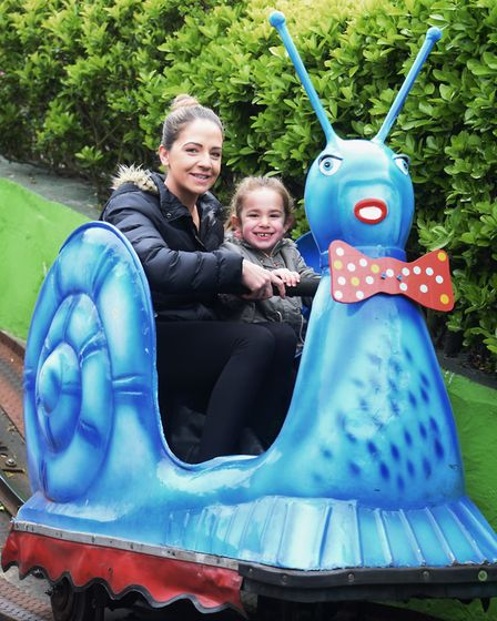 Danielle Hunter, and her daughter, Marcy Reynolds, four, ride the ever popular Joyland Snails at Gre