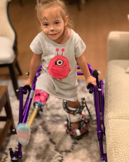 Victoria Komada has taken her first steps after life-changing surgery in America. Picture: Dariusz K