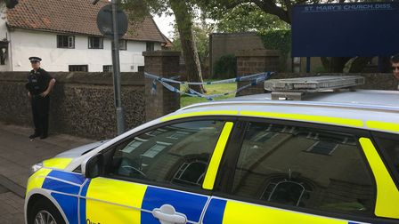 Police remain at St Mary's Church in Diss as investigations continue after a man was was found dead