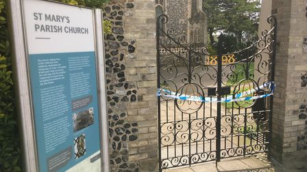 Entrance to St Mary's Church in Diss closed as investigations continue after a body was found in the