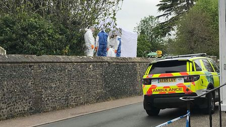 Foresnsics officers in St Mary's church yard in Diss after a body was found. Picture: Ella Wilkinson