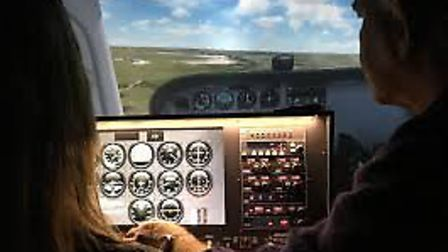 Business writer Caroline Culot at the controls of a flight simulator plane having a go at Sim-Fly wh
