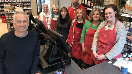 """""""It's good to be home"""" Richard Austin with staff members at Rainbow Wholefoods in Norwich which was"""