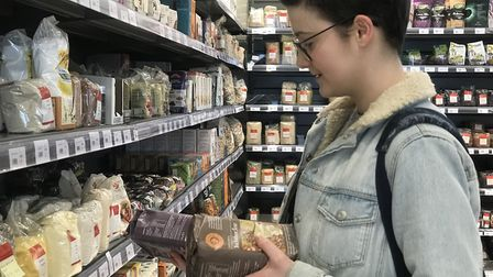 Catherine Dixon from Norwich browsing the shelves of the newly re-opened Rainbow Wholefoods in Norwi