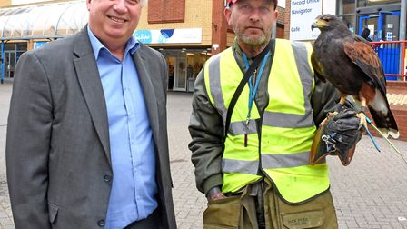 Lowestoft Vision chairman Dan Poitras with Simon Rouse and the hawk, which has been flying over Lowe