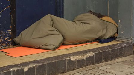 A homeless person sleeping in a doorway. Photo: Getty Images/iStockphoto