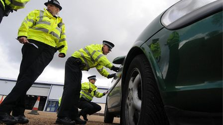 Officers check over a car flagged up by the system Picture: Simon Finlay