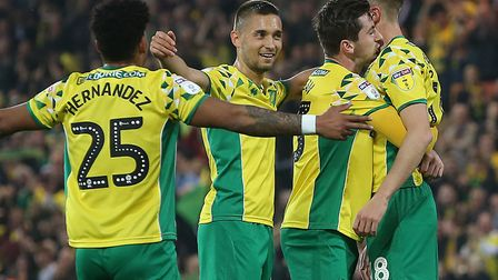 Norwich City players, pictured celebrating Marco Stiepermann's opener against Sheffield Wednesday on