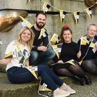 Norfolk Day 2019 merchandise includes bunting and flags. From left, Abbie Smith, Ben Craske, Abigail