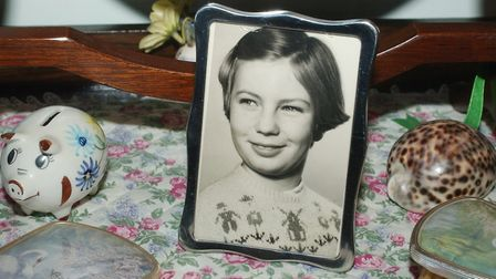 A photograph of April Fabb alongside some of her belongings on the bedroom dressing table of her mum